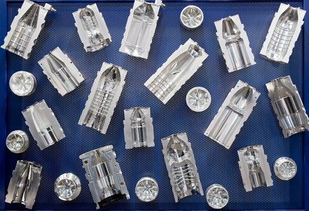 Molds for plastic bottles