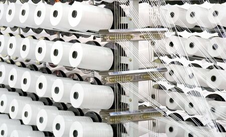 Spools of thread on a loom Stock Photo - 8138216