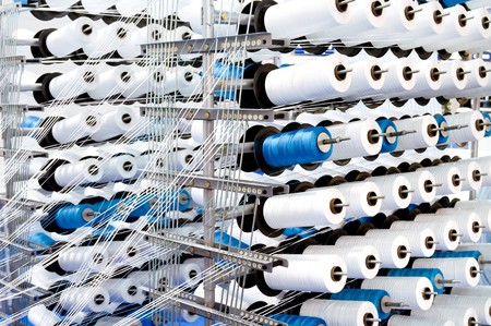 Spools of thread on a loom Stock Photo