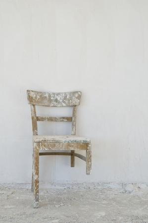 broken chair: Old broken chair at a construction site