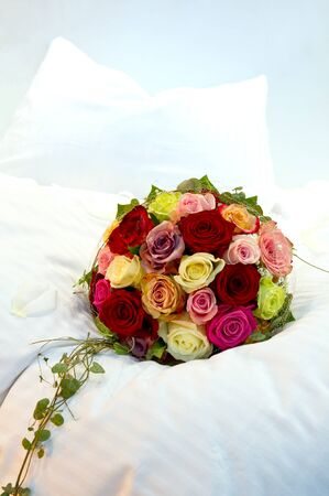 wedding night: Bridal Bouquet on a bed Stock Photo