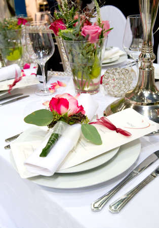 Covered banquet with red roses decoration photo