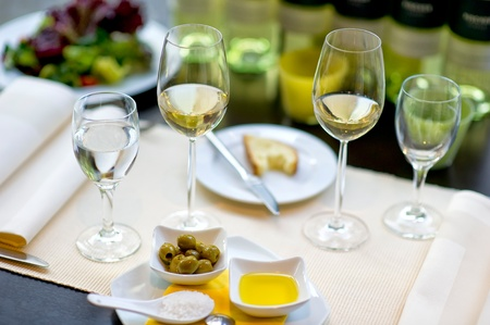 Covered dining table with wine glasses photo