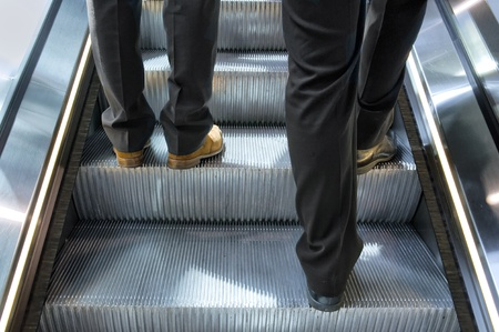 Two men on a escalator