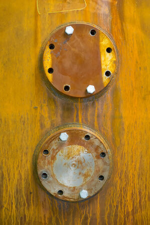 flanges: Flanges on a rusty boiler