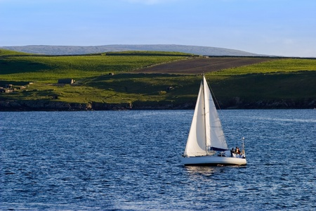 Sailboat at the beatiful coastline Stock Photo