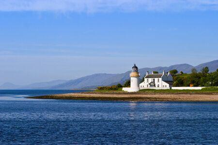 Lighthouse at a beautiful coastline Stock Photo - 9999609