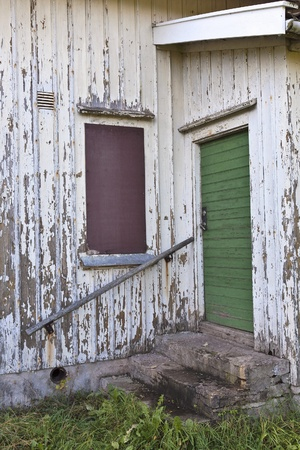 wooden railings: Stairs and door to the cottage