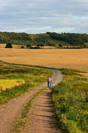 cyclist on a gravel road photo