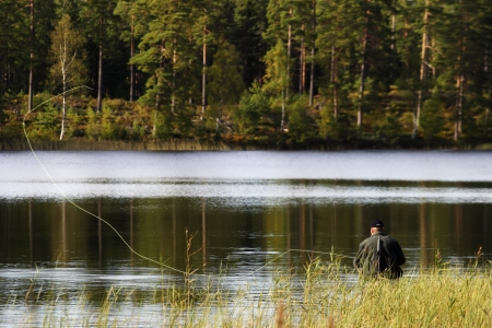 Fly fishing at the lake photo