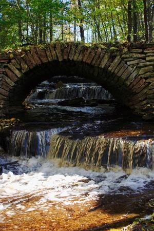 Old stone bridge over a small river. photo