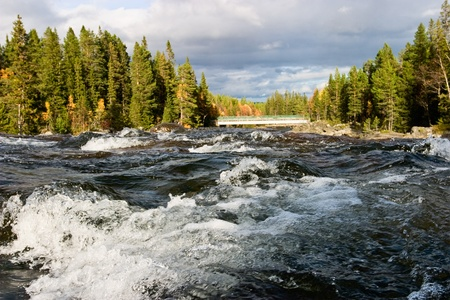 Big river in autumn landscape Imagens