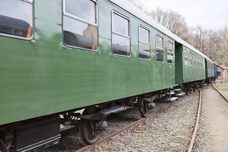Old passenger wagons at a train station photo