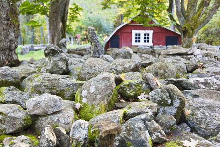 mosses: Stone wall with red barn in countryside