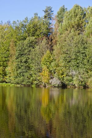 Autumn colors that reflects in the lake Stock Photo - 10610920
