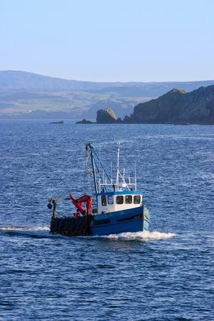 Fishing boat at the bay photo