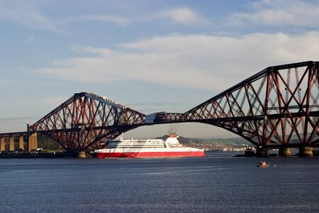 conveyed: Ferry under the Forth Rail Bridge at South Queensferry Scotland