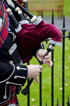 Playing on a bagpipes Stock Photo - 10717422