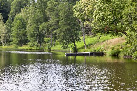 a bathing place: Bathing place with a jetty at the lake Stock Photo