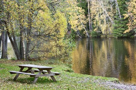 non urban scene: Bench on the shore of a lake Stock Photo