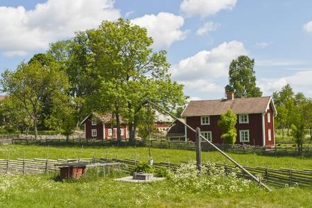 Idyllic farm in summer landscape