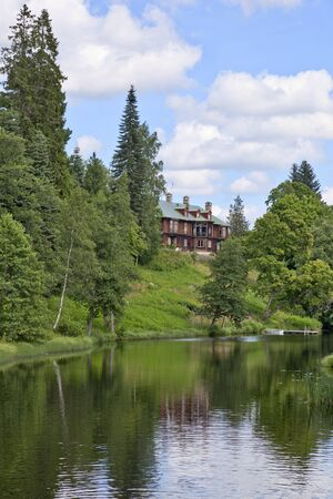 Manor house on the hill by the river photo