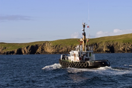 Tug vessel at the coastline Stock Photo - 11830795
