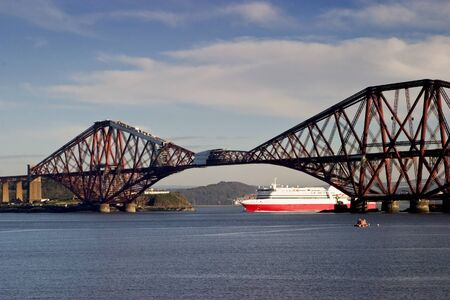 Ferry under the Forth Rail Bridge at South Queensferry Scotland photo