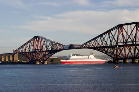convey: Ferry under the Forth Rail Bridge at South Queensferry Scotland