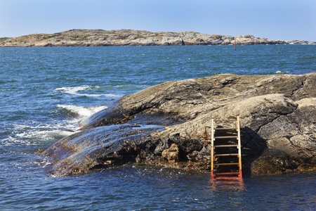 a bathing place: Bathing ladder on the cliff at the bathing place Stock Photo