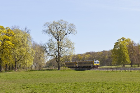 transportaion: Passanger train in countryside landscape Stock Photo