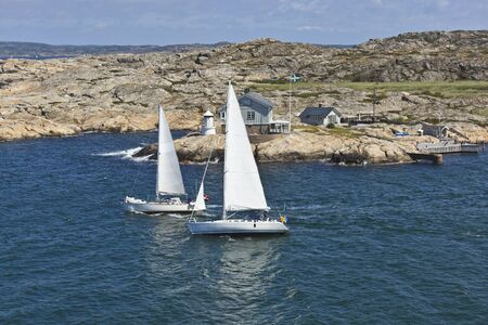 Sailboats and summer cottage in the sea archipelago