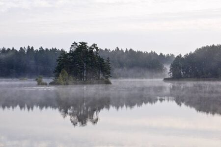 Morning fog on a lake Stock Photo - 13409027