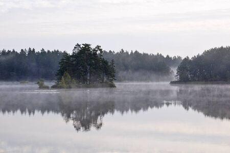 Morning fog on a lake Stock Photo - 13409027