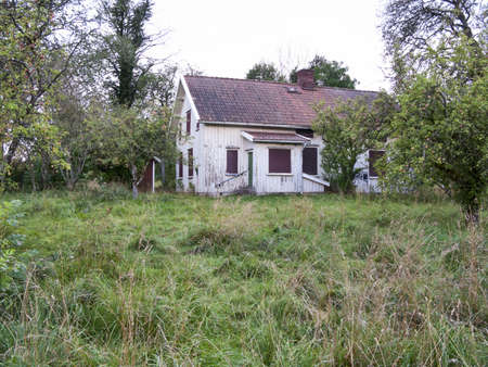 country house: Old abandoned house with garden Stock Photo