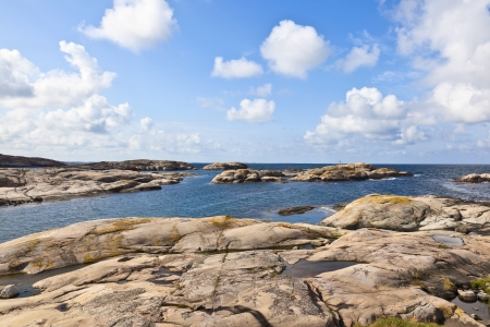 Rocky sea archipelago of islands in the summer time photo