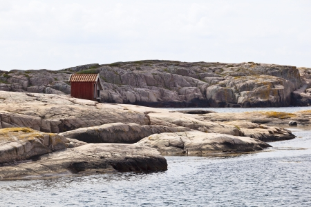 Wood shed on the rocks by the sea