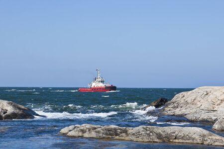 Tugboat: Tugboat at rocky coast