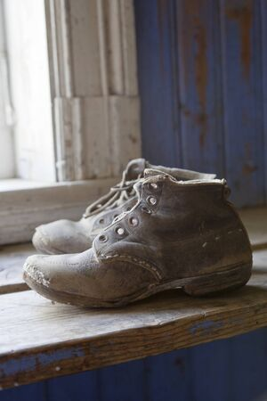Old worn boots on the floor Stock Photo - 13883920