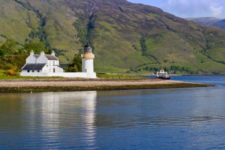 Lighthouse at a beautiful coastline Stock Photo - 13906505