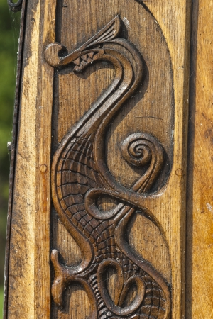 Wood carving of a dragon on a Viking boat
