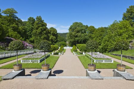Castle garden with flower beds and trees photo