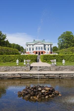 gunnebo: Gunnebo Castle garden in Mondal, Sweden. with trimmed trees along the garden path