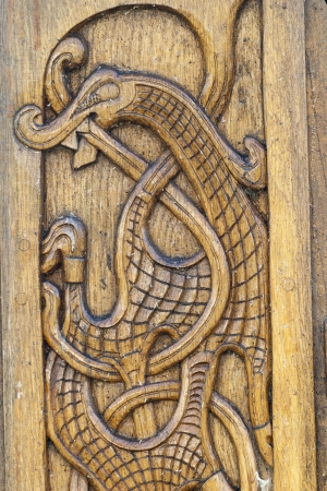 Wood carving of a dragon on a Viking boat Stock Photo - 14328762