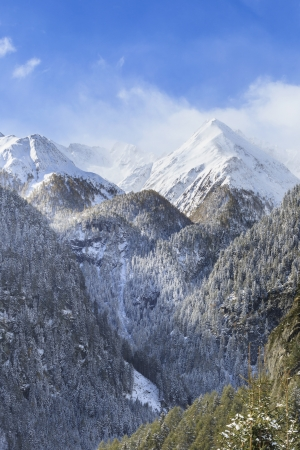 Mountain peaks in wild landscape photo