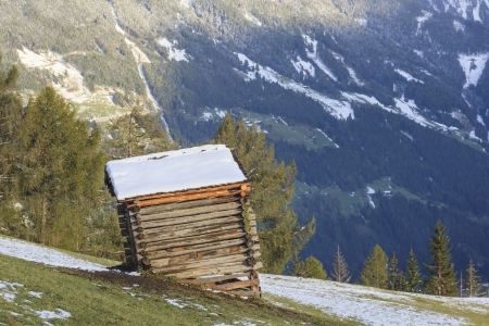 Wooden shed on the field in alp landscapes photo