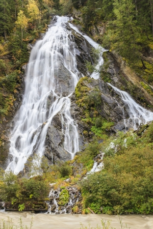 High waterfall at the river photo