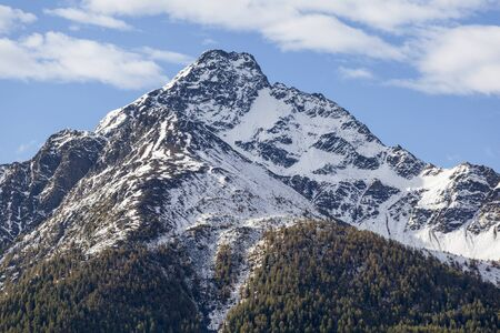 osttirol: High mountain peak with forests and snow