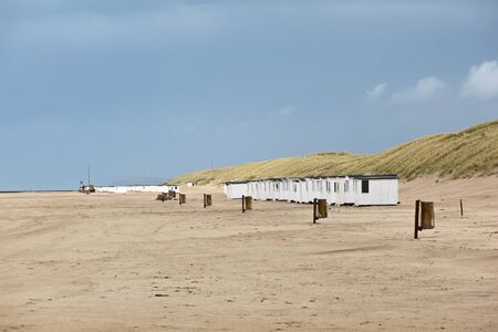 A long row of beach huts photo