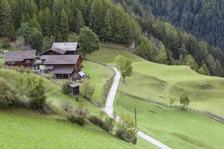 glanz: Alp farm on the slope with fields